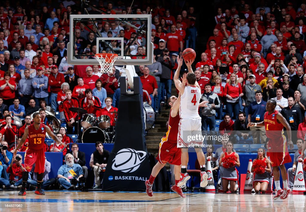 <a gi-track='captionPersonalityLinkClicked' href=/galleries/search?phrase=Aaron+Craft&family=editorial&specificpeople=7348782 ng-click='$event.stopPropagation()'>Aaron Craft</a> #4 of the Ohio State Buckeyes shoots a game-winning three point basket against Georges Niang #31 of the Iowa State Cyclones late in the second half during the third round of the 2013 NCAA Men's Basketball Tournament at UD Arena on March 24, 2013 in Dayton, Ohio.