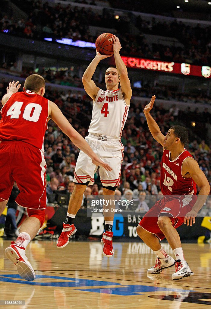 Aaron Craft #4 of the Ohio State Buckeyes shoots between Jared Berggren #40 (L) and Traevon Jackson #12 of the Wisconsin Badgers during the Big Ten Basketball Tournament Championship game at United Center on March 17, 2013 in Chicago, Illinois. Ohio State defeats Wisconsin 50-43.