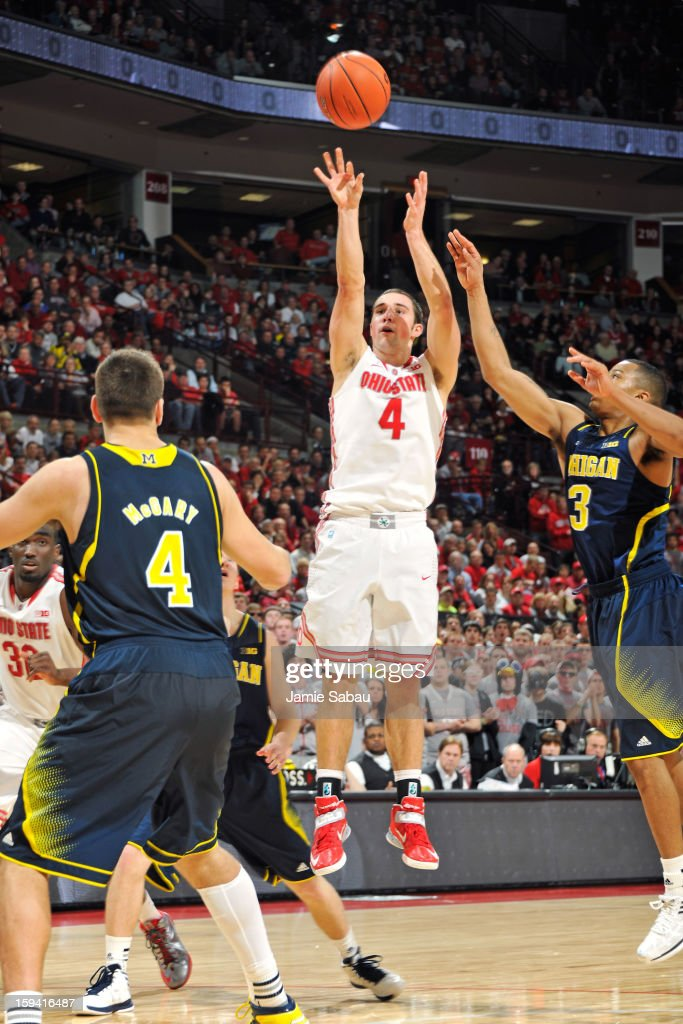 <a gi-track='captionPersonalityLinkClicked' href=/galleries/search?phrase=Aaron+Craft&family=editorial&specificpeople=7348782 ng-click='$event.stopPropagation()'>Aaron Craft</a> #4 of the Ohio State Buckeyes shoots over Trey Burke #3 of the Michigan Wolverines in the second half on January 13, 2013 at Value City Arena in Columbus, Ohio. Ohio State defeated Michigan 56-53.