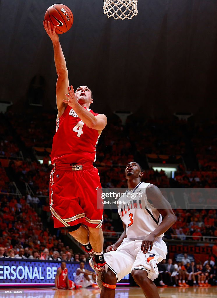 <a gi-track='captionPersonalityLinkClicked' href=/galleries/search?phrase=Aaron+Craft&family=editorial&specificpeople=7348782 ng-click='$event.stopPropagation()'>Aaron Craft</a> #4 of the Ohio State Buckeyes shoots the ball as Brandon Paul #3 of the Illinois Fighting Illini watches at Assembly Hall on January 5, 2013 in Champaign, Illinois. Ilinois defeated Ohio State 74-55.