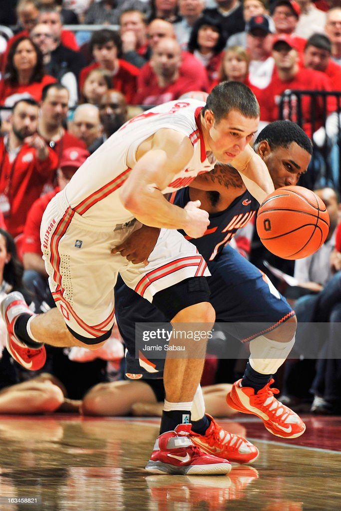 Aaron Craft #4 of the Ohio State Buckeyes steps in to steal the ball away from Tracy Abrams #13 of the Illinois Fighting Illini in the second half on March 10, 2013 at Value City Arena in Columbus, Ohio. Ohio State defeated Illinois 68-55.