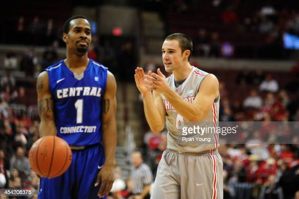 Aaron Craft of the Ohio State Buckeyes taunts Kyle Vinales of the Central Connecticut State Blue Devils on December 7 2013 at Value City Arena in...