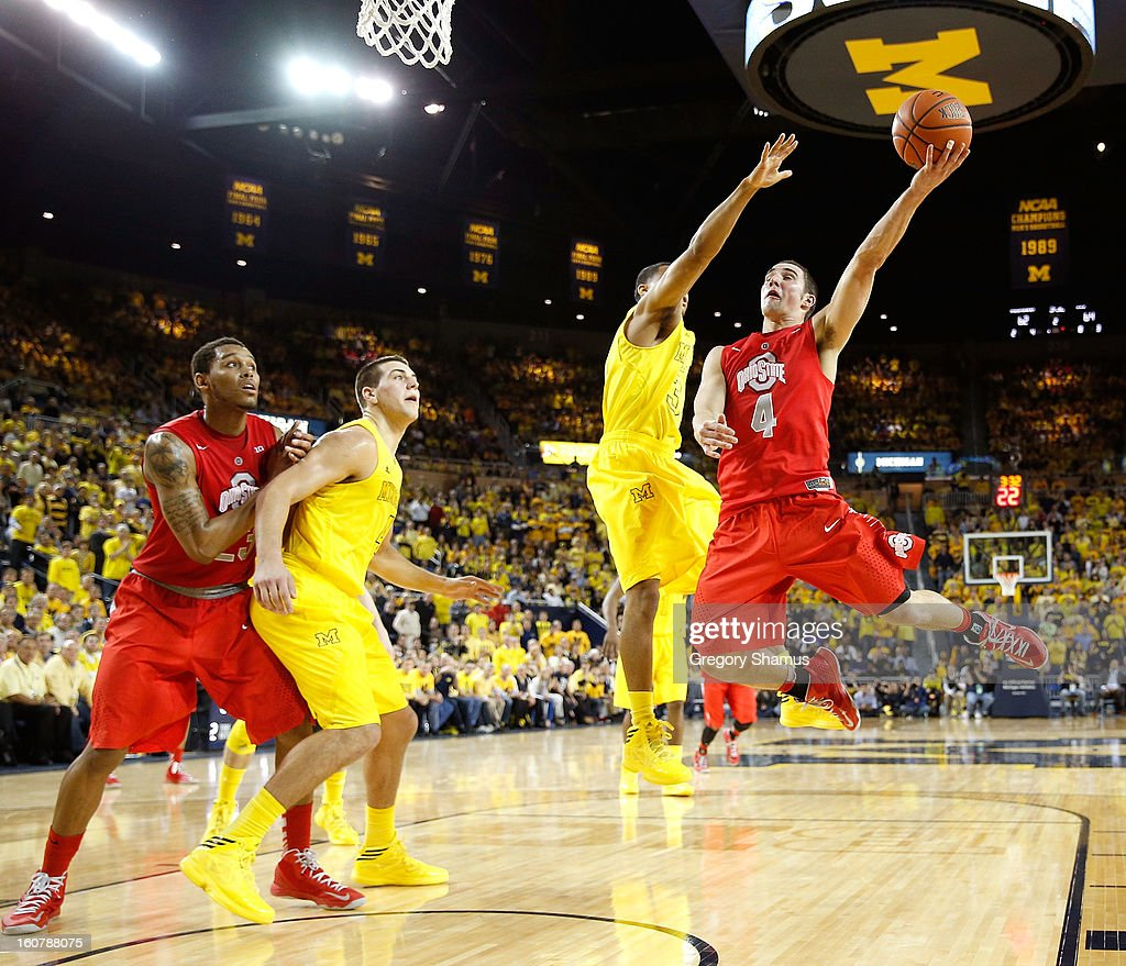 <a gi-track='captionPersonalityLinkClicked' href=/galleries/search?phrase=Aaron+Craft&family=editorial&specificpeople=7348782 ng-click='$event.stopPropagation()'>Aaron Craft</a> #4 of the Ohio State Buckeyes tries to get a second half shot off around Trey Burke #3 of the Michigan Wolverines at Crisler Center on February 5, 2013 in Ann Arbor, Michigan. Michigan won the game 76-74 in overtime.