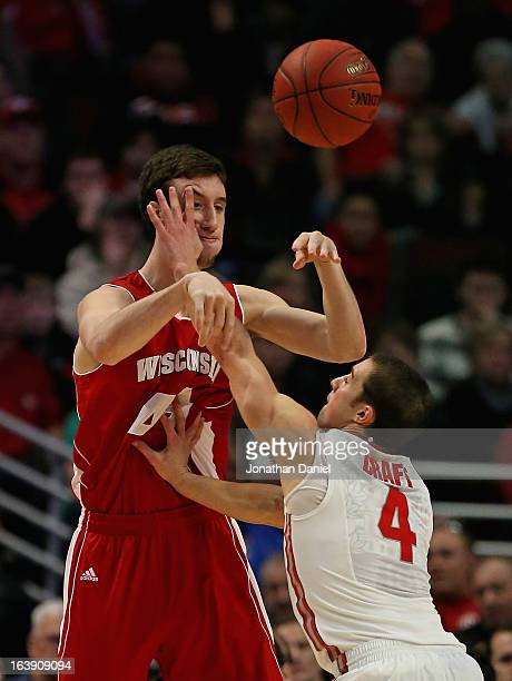 Aaron Craft of the Wisconsin Badgers hits Frank Kaminsky of the Ohio State Buckeyes during the Big Ten Basketball Tournament Championship game at...