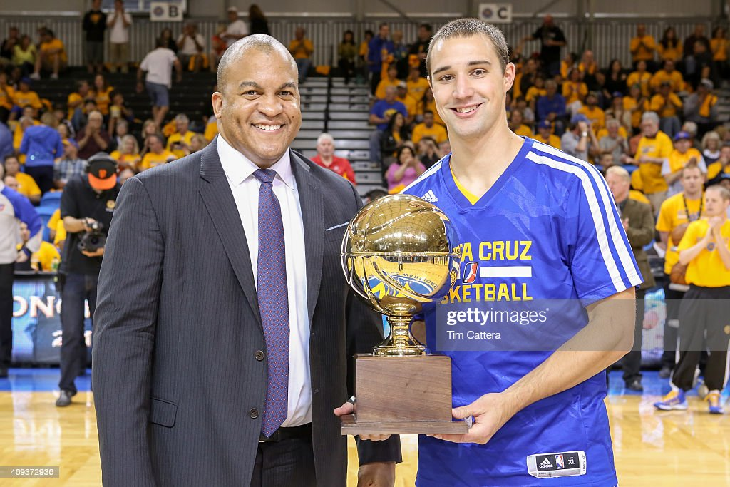 <a gi-track='captionPersonalityLinkClicked' href=/galleries/search?phrase=Aaron+Craft&family=editorial&specificpeople=7348782 ng-click='$event.stopPropagation()'>Aaron Craft</a> receives the Defense Player Award from President Malcolm Turner at the Santa Cruz Warriors play against the Oklahoma City Blue during the Western Conference Semi-Final NBA D-League game on April 10, 2015 at Kaiser Permanente Arena in Santa Cruz, California.