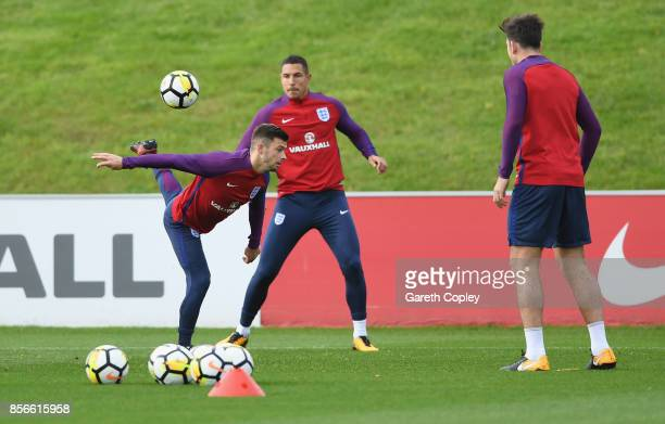 Aaron Cressell Jake Livermore and Harry Maguire of England in action during an England training session at St Georges Park on October 2 2017 in...