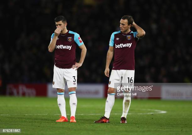 Aaron Cresswell and Mark Noble of West Ham United look dejected during the Premier League match between Watford and West Ham United at Vicarage Road...