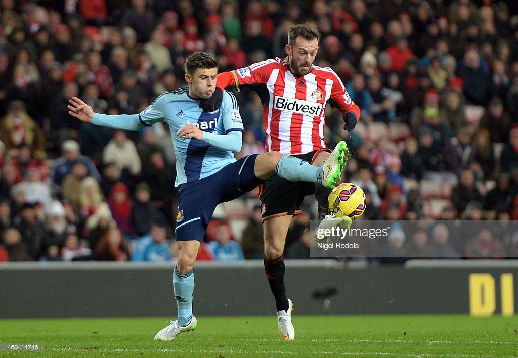 Aaron Cresswell of West Ham and Steven Fletcher of Sunderland compete for the ball during the Barclays Premier League match between Sunderland and West Ham United at Stadium of Light on December 13, 2014 in Sunderland, England.