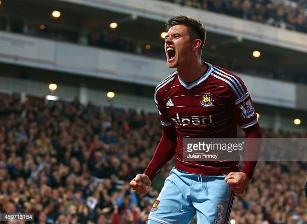 Aaron Cresswell of West Ham celebrates scoring opening goal during the Barclays Premier League match between West Ham United and Newcastle United at...