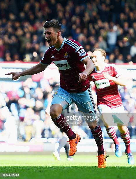 Aaron Cresswell of West Ham celebrates scoring the first goal during the Barclays Premier League match between West Ham United and Stoke City at...