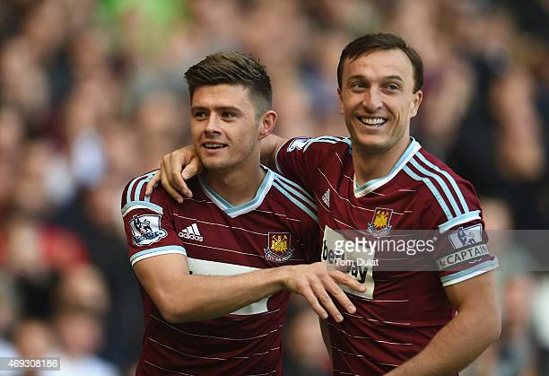 Aaron Cresswell of West Ham celebrates scoring the first goal with Mark Noble of West Ham during the Barclays Premier League match between West Ham...