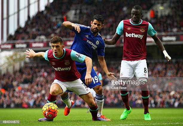 Aaron Cresswell of West Ham United and Diego Costa of Chelsea compete for the ball during the Barclays Premier League match between West Ham United...