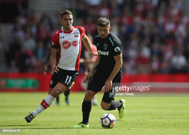 Aaron Cresswell of West Ham United and Dusan Tadic of Southampton battle for possession during the Premier League match between Southampton and West...