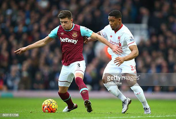 Aaron Cresswell of West Ham United and Jordon Ibe of Liverpool compete for the ball during the Barclays Premier League match between West Ham United...