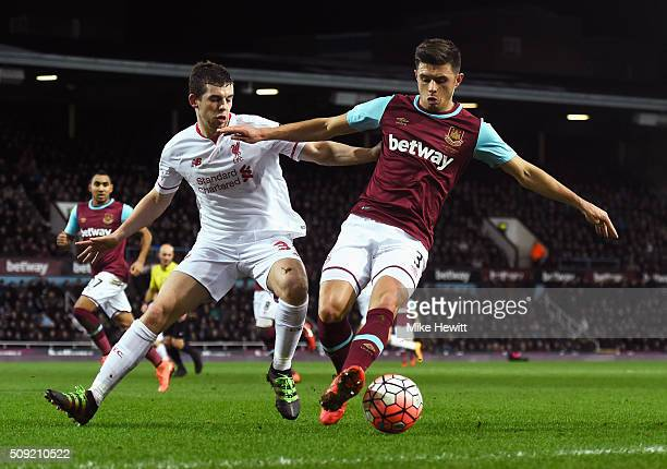 Aaron Cresswell of West Ham United holds off Jon Flanagan of Liverpool during the Emirates FA Cup Fourth Round Replay match between West Ham United...