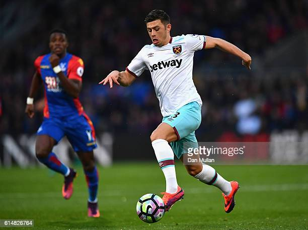 Aaron Cresswell of West Ham United is chased by Wilfried Zaha of Crystal Palace during the Premier League match between Crystal Palace and West Ham...
