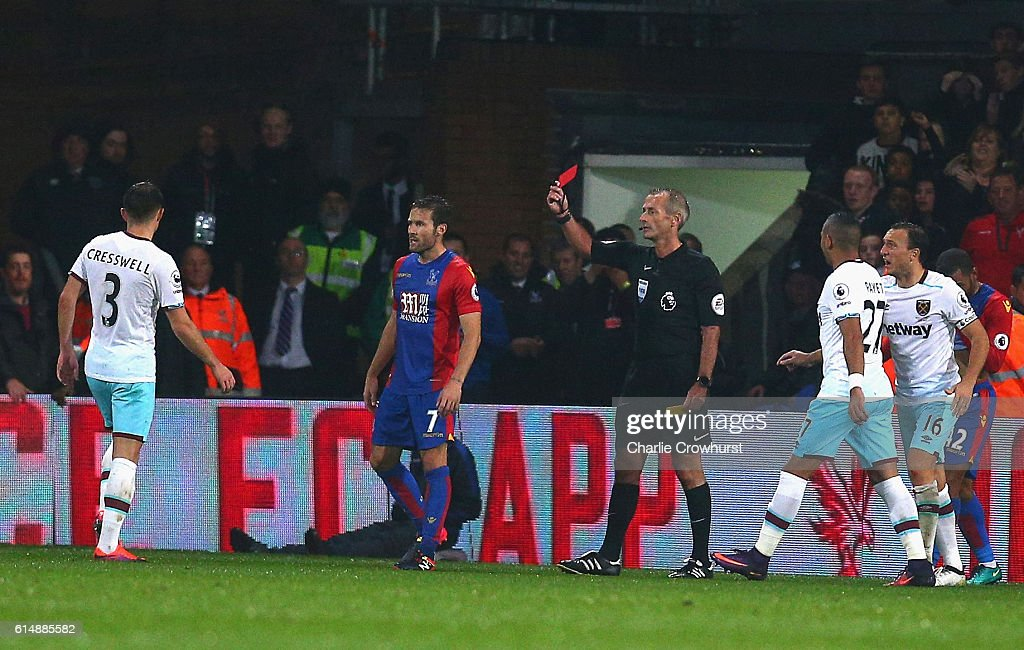 Aaron Cresswell of West Ham United (3) is shown a red card and is sent off by referee Martin Atkinson during the Premier League match between Crystal Palace and West Ham United at Selhurst Park on October 15, 2016 in London, England.