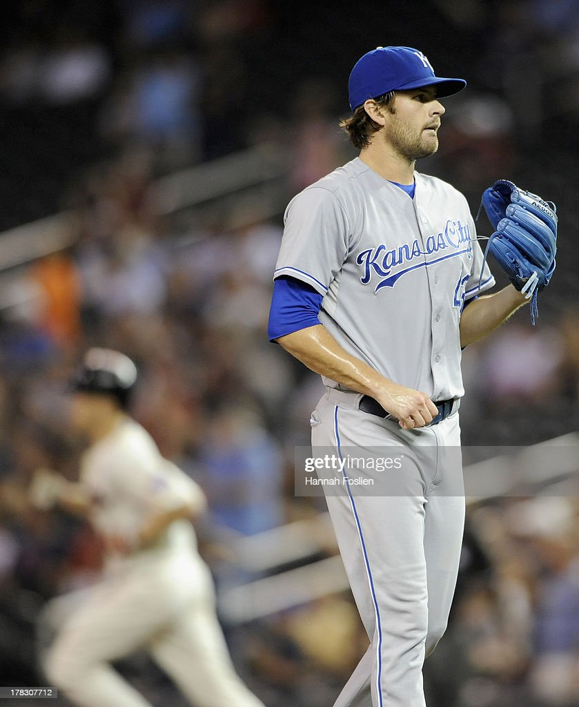Aaron Crow #43 of the Kansas City Royals reacts as <a gi-track='captionPersonalityLinkClicked' href=/galleries/search?phrase=Justin+Morneau&family=editorial&specificpeople=211556 ng-click='$event.stopPropagation()'>Justin Morneau</a> #33 of the Minnesota Twins rounds the bases after hitting solo home run during the ninth inning of the game on August 28, 2013 at Target Field in Minneapolis, Minnesota. The Royals defeated the Twins 8-1.