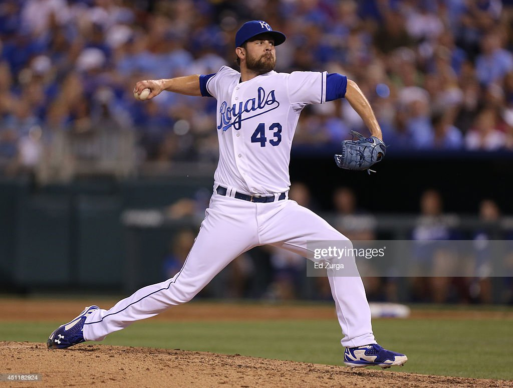 Aaron Crow #43 of the Kansas City Royals throws in the seventh inning against the Los Angeles Dodgers at Kauffman Stadium on June 24, 2014 in Kansas City, Missouri.