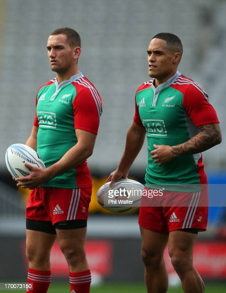 Aaron Cruden and Aaron Smith of the All Blacks during the New Zealand All Blacks Captain's Run at Eden Park on June 7 2013 in Auckland New Zealand