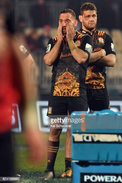 Aaron Cruden and Tawera KerrBarlow of the Chiefs look dejected after their loss in the Super Rugby Semi Final match between the Crusaders and the...