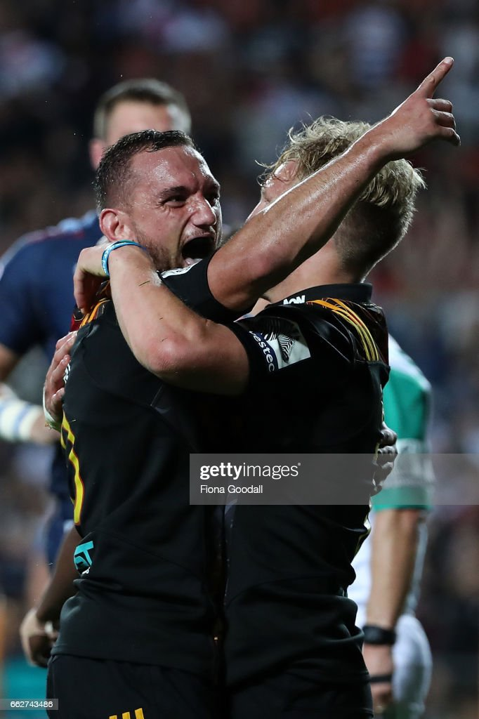 Aaron Cruden (L) celebrates with Damian McKenzie (R) after his try for the Chiefs during the round six Super Rugby match between the Chiefs and the Bulls at Waikato Stadium on April 1, 2017 in Hamilton, New Zealand.
