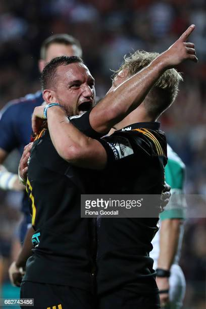 Aaron Cruden celebrates with Damian McKenzie after his try for the Chiefs during the round six Super Rugby match between the Chiefs and the Bulls at...