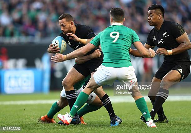 Aaron Cruden of New Zealand is tackled by Conor Murray of Ireland during the international match between Ireland and New Zealand at Soldier Field on...