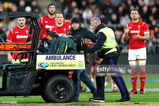 Aaron Cruden of the All Blacks applauded by Welsh players as he is stretchered off the field with an injury during the International Test match...