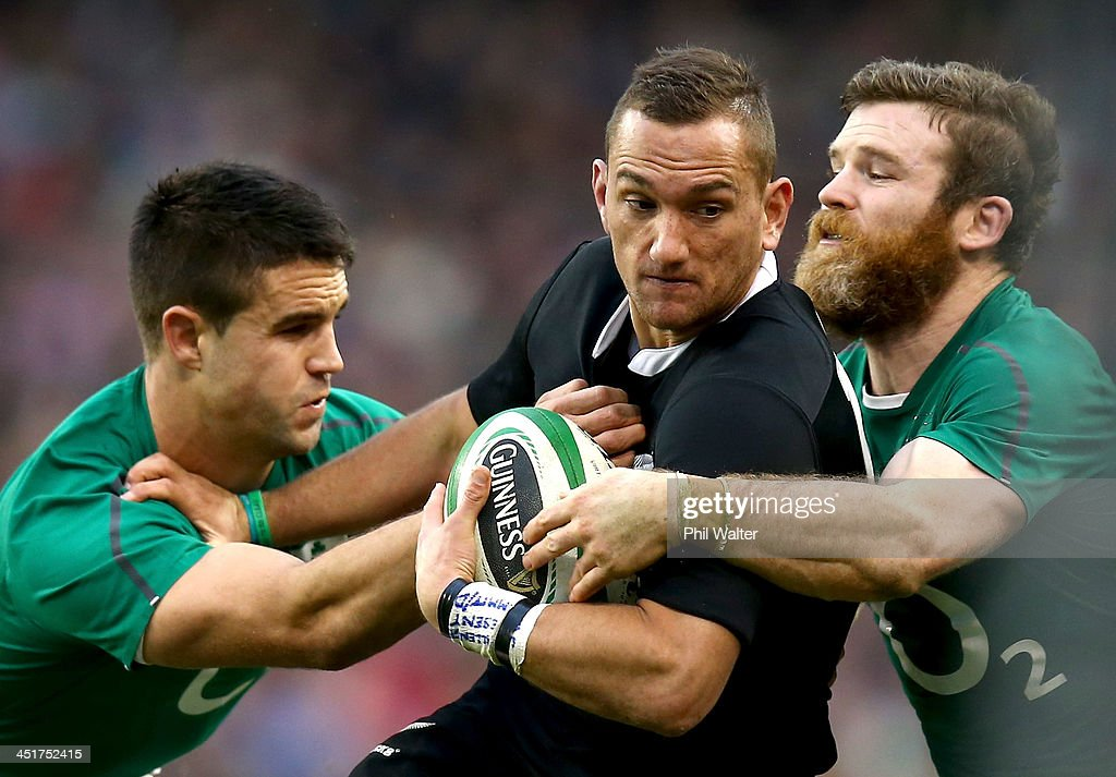 <a gi-track='captionPersonalityLinkClicked' href=/galleries/search?phrase=Aaron+Cruden&family=editorial&specificpeople=5501441 ng-click='$event.stopPropagation()'>Aaron Cruden</a> of the All Blacks is tackled by <a gi-track='captionPersonalityLinkClicked' href=/galleries/search?phrase=Conor+Murray+-+Rugby+Player&family=editorial&specificpeople=6820654 ng-click='$event.stopPropagation()'>Conor Murray</a> (L) and <a gi-track='captionPersonalityLinkClicked' href=/galleries/search?phrase=Gordon+D%27Arcy&family=editorial&specificpeople=220551 ng-click='$event.stopPropagation()'>Gordon D'Arcy</a> (R) of Ireland during the International match between Ireland and the New Zealand All Blacks at Aviva Stadium on November 24, 2013 in Dublin, Ireland.