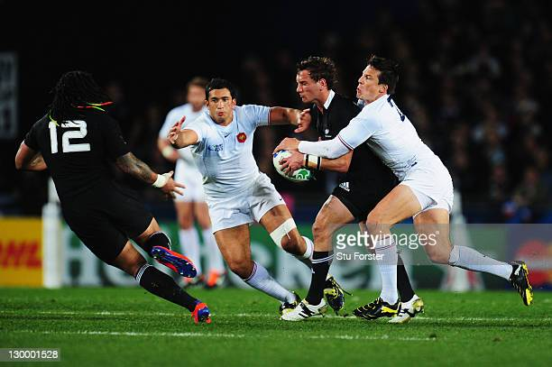 Aaron Cruden of the All Blacks is tackled by Francois TrinhDuc of France during the 2011 IRB Rugby World Cup Final match between France and New...