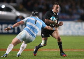Aaron Cruden of the All Blacks is tackled by Marcos Ayerza during The Rugby Championship match between Argentina and the New Zealand All Blacks at...