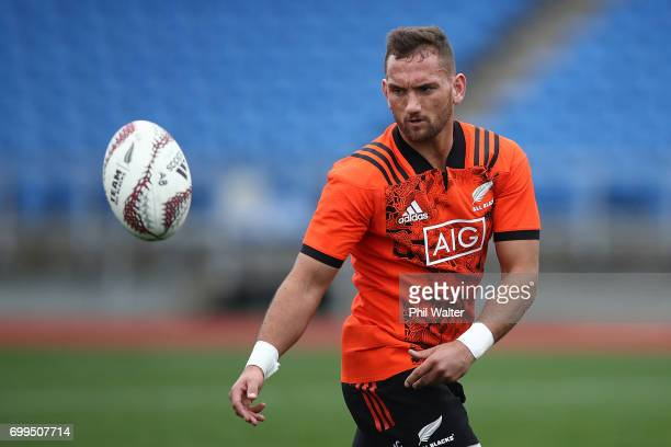 Aaron Cruden of the All Blacks passes during a New Zealand All Blacks training session at Trusts Stadium on June 22 2017 in Auckland New Zealand