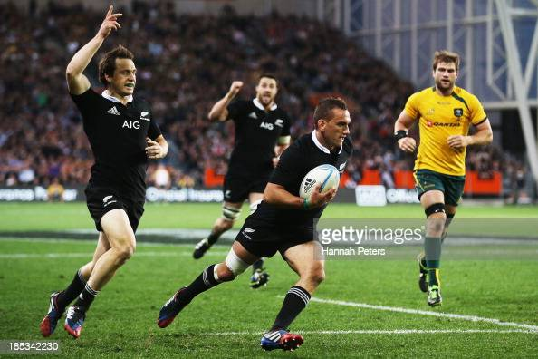 Aaron Cruden of the All Blacks runs into score a try during The Rugby Championship match between the New Zealand All Blacks and the Australian...