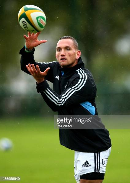 Aaron Cruden of the All Blacks takes a pass during a New Zealand All Blacks training session at the Rugby Club Suresnois on November 5 2013 in Paris...