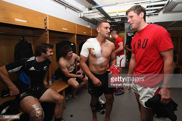 Aaron Cruden of the All Blacks talks to Rhys Priestland of Wales in the changing room following the international match between Wales and New Zealand...