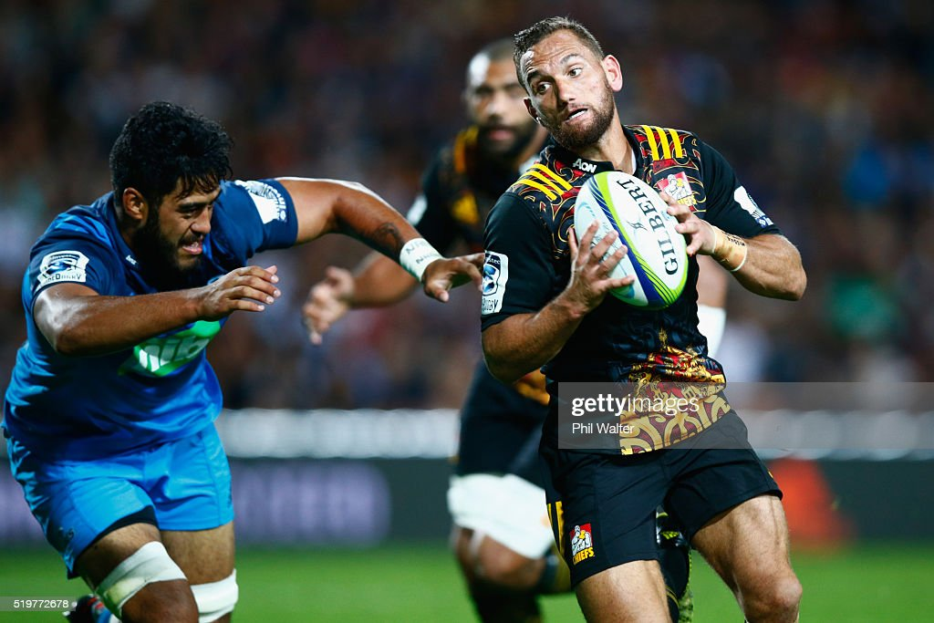Aaron Cruden of the Chiefs beats the tackle of Akira Ioane of the Blues to score a try during the round seven Super Rugby match between the Chiefs and the Blues on April 8, 2016 in Hamilton, New Zealand.
