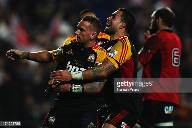 Aaron Cruden of the Chiefs celebrates with Liam Messam of the Chiefs after scoring a try during the Super Rugby semi final match between the Chiefs...