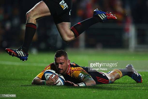 Aaron Cruden of the Chiefs dives over to score a try during the Super Rugby semi final match between the Chiefs and the Crusaders at Waikato Stadium...