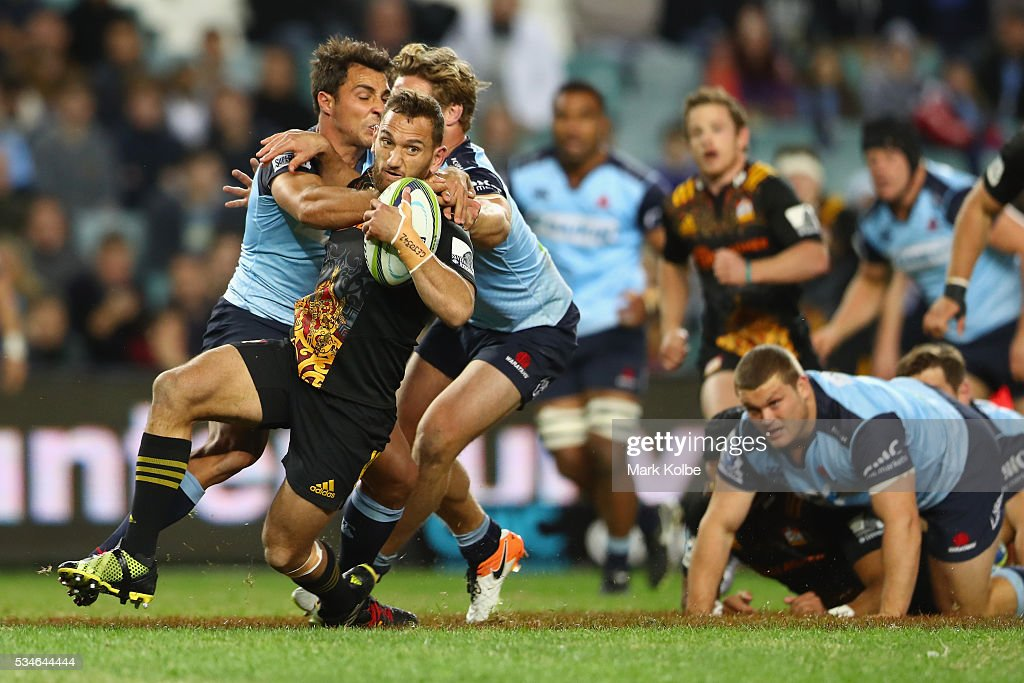 Aaron Cruden of the Chiefs is tackled during the round 14 Super Rugby match between the Waratahs and the Chiefs at Allianz Stadium on May 27, 2016 in Sydney, Australia.