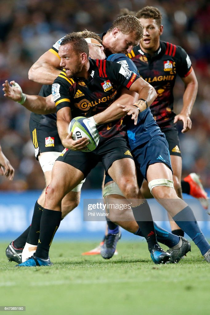 Aaron Cruden of the Chiefs is tackled during the round two Super Rugby match between the Chiefs and the Blues at Rugby Park on March 3, 2017 in Hamilton, New Zealand.