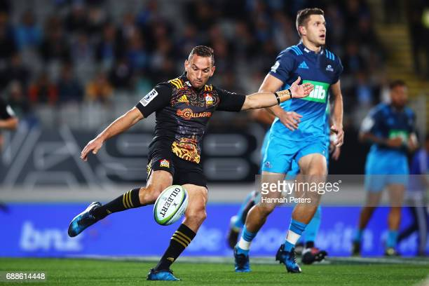 Aaron Cruden of the Chiefs kicks the ball through during the round 14 Super Rugby match between the Blues and the Chiefs and Eden Park on May 26 2017...