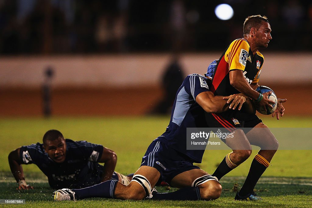 <a gi-track='captionPersonalityLinkClicked' href=/galleries/search?phrase=Aaron+Cruden&family=editorial&specificpeople=5501441 ng-click='$event.stopPropagation()'>Aaron Cruden</a> of the Chiefs looks to offload the ball during the round seven Super Rugby match between the Chiefs and the Blues at Bay Park on March 30, 2013 in Tauranga, New Zealand.
