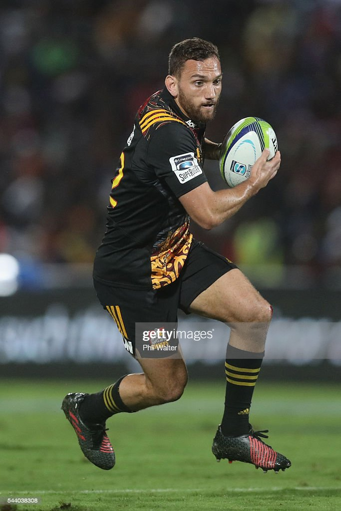 <a gi-track='captionPersonalityLinkClicked' href=/galleries/search?phrase=Aaron+Cruden&family=editorial&specificpeople=5501441 ng-click='$event.stopPropagation()'>Aaron Cruden</a> of the Chiefs makes a break during the round 15 Super Rugby match between the Chiefs and the Crusaders at ANZ Stadium on July 1, 2016 in Suva, Fiji.