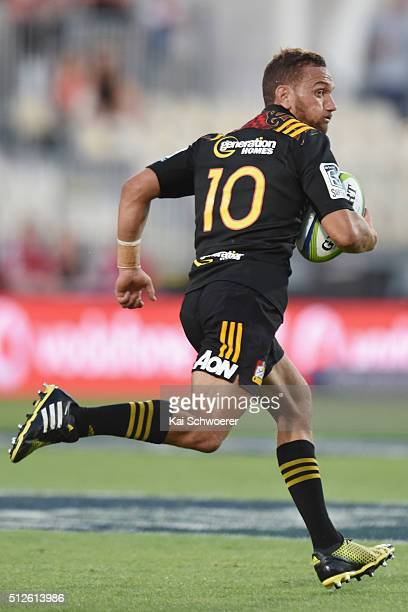 Aaron Cruden of the Chiefs runs with the ball during the round one Super Rugby match between the Crusaders and the Chiefs at AMI Stadium on February...