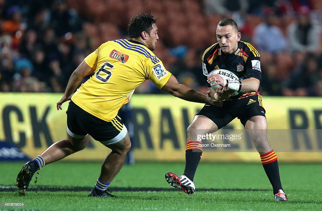 <a gi-track='captionPersonalityLinkClicked' href=/galleries/search?phrase=Aaron+Cruden&family=editorial&specificpeople=5501441 ng-click='$event.stopPropagation()'>Aaron Cruden</a> of the Chiefs skips inside <a gi-track='captionPersonalityLinkClicked' href=/galleries/search?phrase=Jack+Lam&family=editorial&specificpeople=2920396 ng-click='$event.stopPropagation()'>Jack Lam</a> of the Hurricanes during the round 18 Super Rugby match between the Chiefs and the Hurricanes at Waikato Stadium on July 4, 2014 in Hamilton, New Zealand.