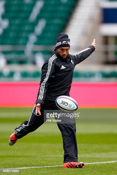 Aaron Cruden of the New Zealand All Blacks takes a kick during a kicking practice session at Twickenham Stadium on November 7 2014 in London England