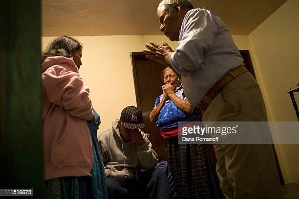 Aaron Cruz Cruz age 17 bows his head as his mother Naomi and his grandparents Rosa Cruz Juarez and Guillermo Cruz Cruz pray for his safety while...