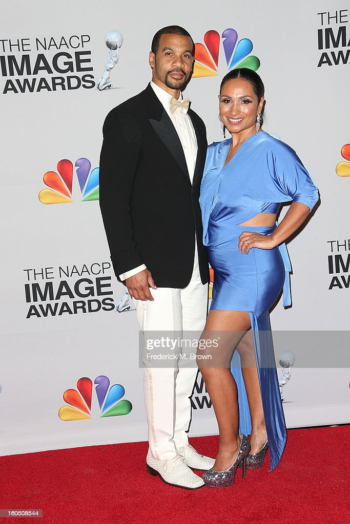 Aaron D. Spears and his wife Estela pose in the press room during the 44th NAACP Image Awards at The Shrine Auditorium on February 1, 2013 in Los Angeles, California.