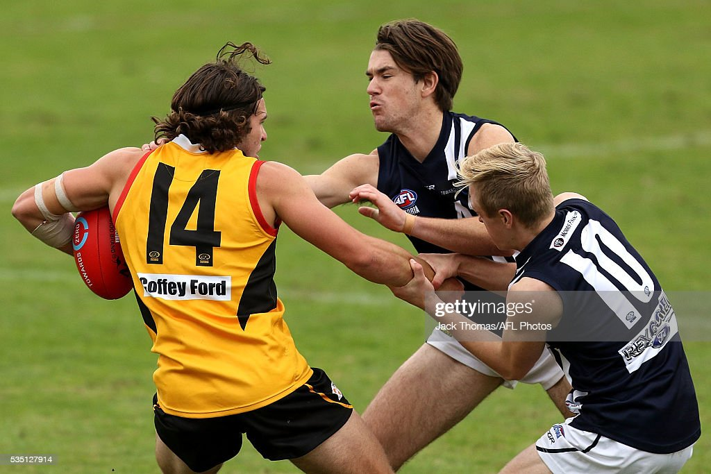 Aaron Darling of the Dandenong Stingrays is tackled during the round eight TAC Cup match between Dandenong Stingrays and Geelong Falcons at Shepley Oval on May 29, 2016 in Melbourne, Australia.